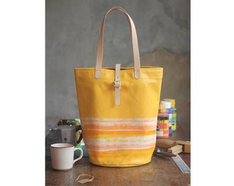 canvas tote bag with leather handle.
