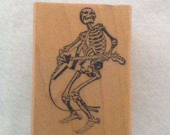 Skeleton Playing Electric Guitar by Gumbo Graphics - Used