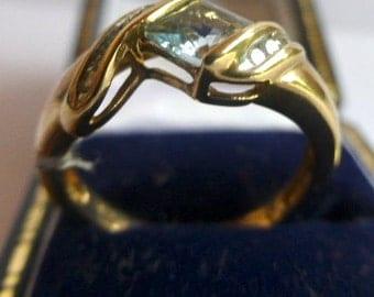 A 9 Carat Gold Diamond And Blue Topaz Ring.Hallmarked