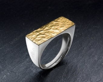 Hammered ring made from 18k gold and sterling silver. Handmade jewelry from goldsmith.