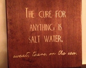 "Wood sign ""the cure for anything is salt water. Sweat, tears, or the sea"""