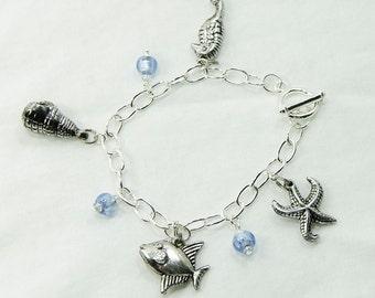 Seaside charm bracelet with blue glass