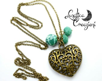 Bronze long necklace with heart-shaped pendant and earrings vintage style crystals