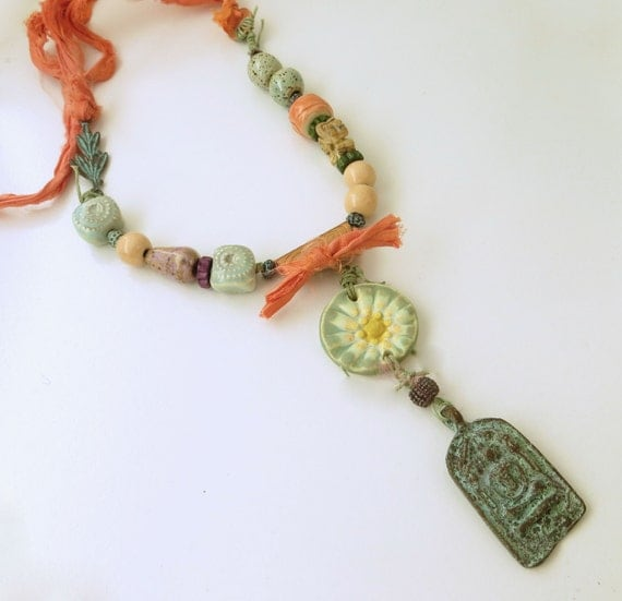 Fresh Flowers and Relic Necklace with artisan-made pottery beads and copper accents