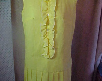 1960s Yellow Dresss with Ruffle down the front.  Am not sure what fabric is, I think NylonMed