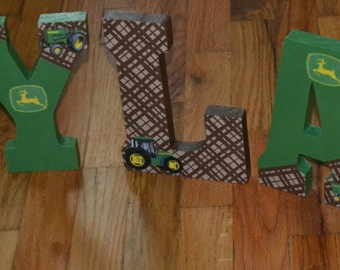 Tractor theme spells out your childs name. Hangs on wall