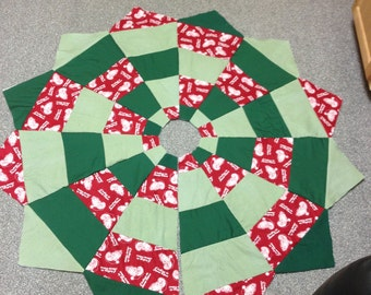homemade quilted Christmas tree skirt.