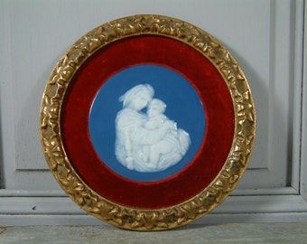 Vintage french porcelain Madonna and Child with red velvet and gilded wood frame. Christian art.