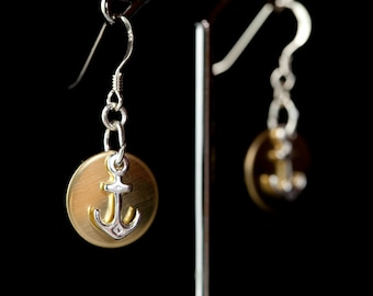 Sterling silver anchor charms with brass round discs.