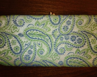Vintage tapestry clutch in green and blue with kiss lock closure.