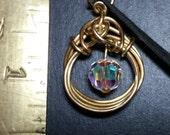Merlin's Gold herringbone weave Aurora Borealis crystal pendant