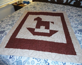 rocking horse baby blanket in maroon and tan cotton fabric, approx 42x49 in