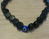 Black stone and blue evil eye men's bracelet