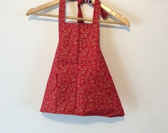 Hand made apron in Christmas colors for a child.