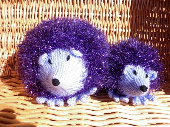 Mother and baby hedgehogs knitted in tinsel wool so they shine