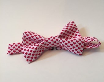 White bow tie with red hearts