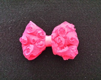 rose hairbow on an aligator clip.  you pick color.