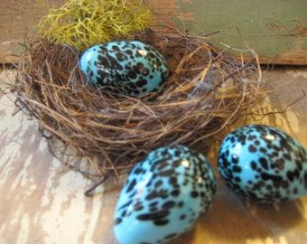 Robins egg blue speckled glass egg.