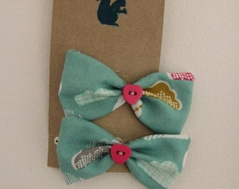 Cloud fabric bow on a snap hair clip with a pink heart button