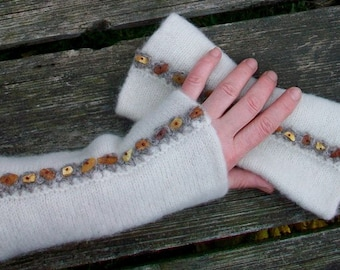 Hand knitted and felted fingerless gloves for women.