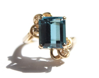 Emerald Cut Blue Topaz Ring (952)