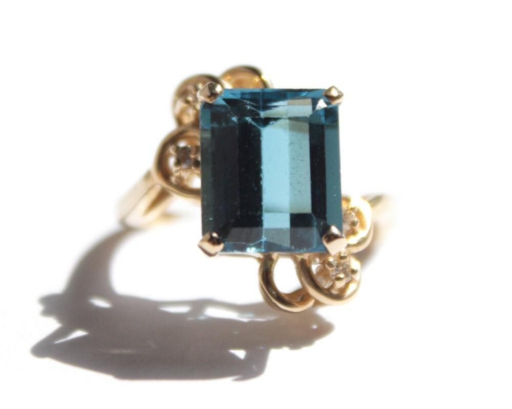 emerald cut blue topaz ring 952