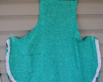 Green apron with white eyelet trim