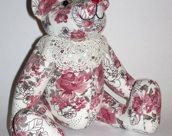 Toy Bear in roses