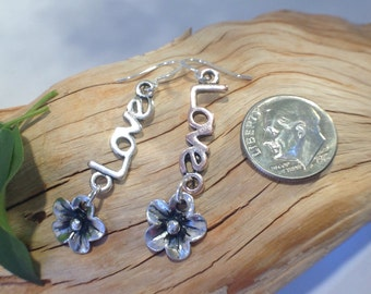 Silver LOVE and flower earrings.