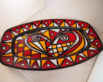 A red, yellow, white and black oblong tray from the Liz Ellard 'Queen of Hearts' series.