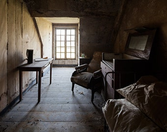 Chiaroscuro photography of a bedroom, in an abandoned castle in France