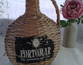 Vintage Portomar wicker covered wine bottle or demijohn, dame-jeanne, carboy - unusual oval shape and in lovely vintage condition.