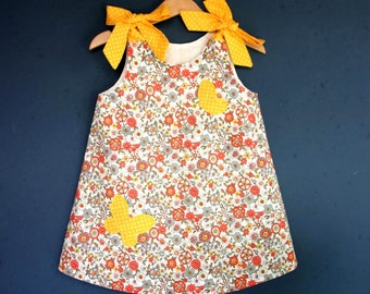 Floral baby dress decorated with butterflies, yellow peas shoulder knots