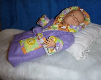 Newborn bathrobe or leisure robe in cozy fleece with washed cotton flannel lining.