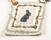 Miniature aret quilt, wearable necklace, mixed media, gray rabbit