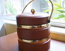 "Leonard Silver Co LLC ""Shelton Ware"" Faux leather with gold tone bands vintage ice bucket from the mid 1970's.  Condition is stunning!  RARE"