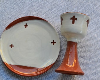 A Red and White Communion Chalice and Paten: Three Carved Crosses