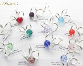 Claire - classic Birth Stone crystal bead earrings on stainless steel hoops. Each earring weighs 3 grams. - TZE530215