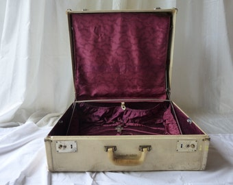 Vintage 1940's traveliare suitcase with brilliant purple cloud lining! Satin pockets, dividers and hanging bars includes matching hanger.