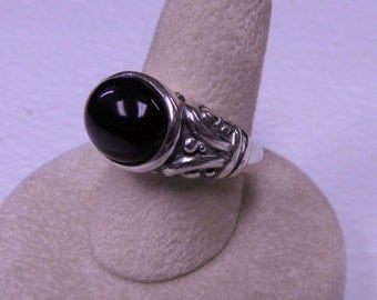 This ring is a black onyx size 7.