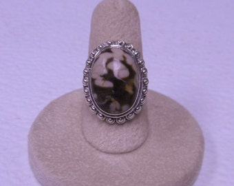 This ring has a peanut jasper stone size 7  .  It has a split band .