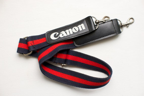 canon camera strap with canon logo red and blue with white