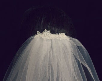 White Mid-Length Bridal Veil with Lace-Adorned Comb