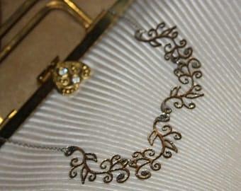 Silver/gold laser cut leather Art Nouveau necklace