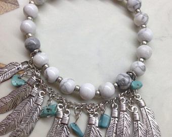 Beaded bracelet with feather fringe detail