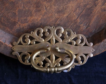 Brass handle and decorative  plate.