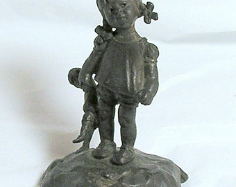 Young Girl Holding Doll: Mia Krantz Bronze Sculpture