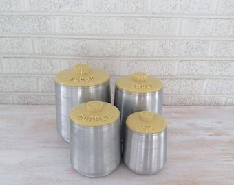 Mid Century Modern Kromex Canister Set in Spun Aluminum/Yellow Lids