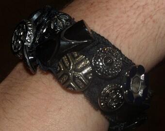 Georgeous Antique Button Bracelet on Black Elastic Band