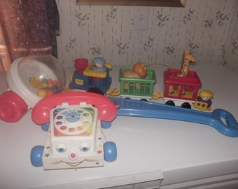 three vintage fisher price toys